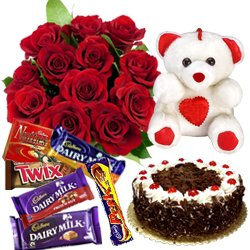 12 Exclusive  Dutch Red  Roses  Bouquet with Cake, Assorted Cadburys Chocolate and  a Cute Teddy Bear