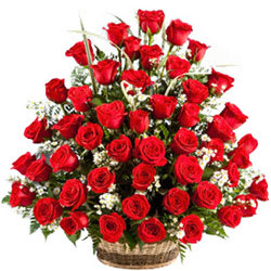 Joyful Presentation of Red Roses in a Lovely Basket