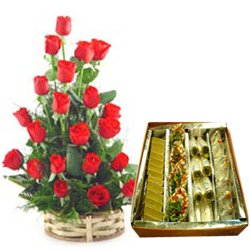 Enticing Assorted Sweets with Red Roses Basket Arrangement