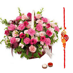 Pretty Gift Arrangement of Roses and Seasonal Flowers in a Basket with free Rakhi, Roli Tika and Chawal for Special Rakhi Festival<br>