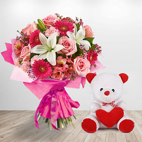 Basket Arrangement of Teddy with Lilies N Gerberas