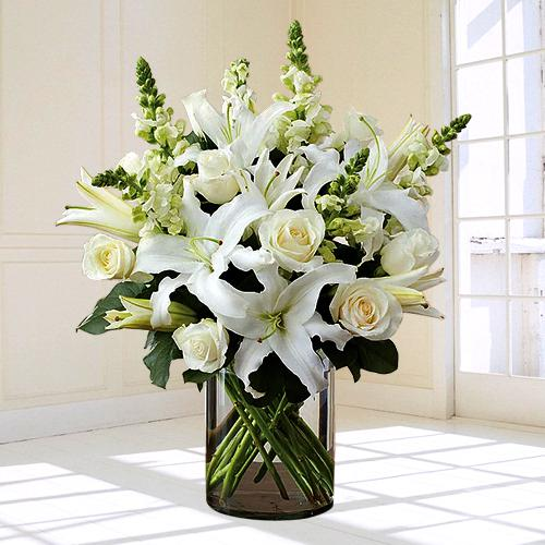 Graceful White Flowers in Glass Vase for Condolence