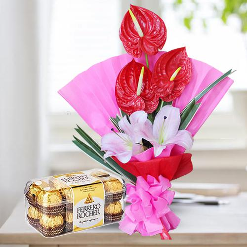 Classy Bouquet of Red Anthurium n Pink Lilies with Ferrero Rocher